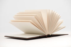 Book pages. Open book pages in white background, close-up Royalty Free Stock Images