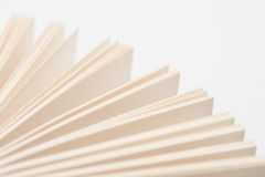 Book pages. Open book pages in white background, close-up Stock Images