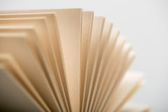 Book pages. Open book pages in white background, close-up Royalty Free Stock Photo