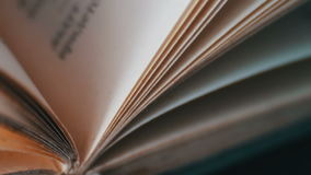 Book pages turning. Scrolling a Book in Macro.Turning the pages of an old book close-up stock video