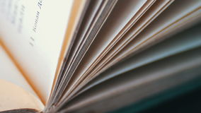 Book pages turning stock video footage