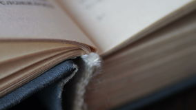 Book pages turning. Scrolling a Book in Macro.Turning the pages of an old book close-up stock footage