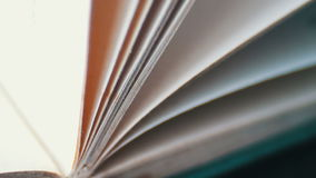 Book pages turning. Scrolling a Book in Macro.Turning the pages of an old book close-up stock video footage