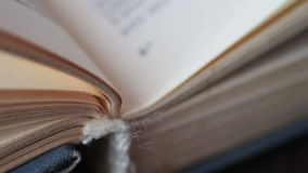 Book pages turning stock footage