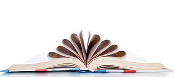 Book with the pages wrapped up in a tube, Royalty Free Stock Photo
