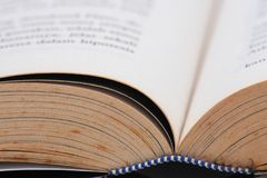 Book Pages. A yellowing book pages shows a detail of one corner of the book, any educational concept may fit Stock Photo