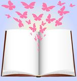 Book and paper butterfly. On a blue background has a large open book, from which emerge abstract pink butterfly Stock Photo