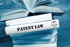Book with Patent Law word on table in a courtroom or enforcement office. Toned image Royalty Free Stock Photography