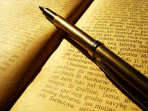 Book and pen. Old book and golden pen Stock Photography
