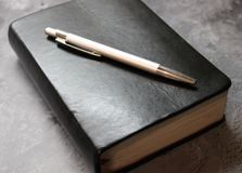 A book and a pen. With marble background royalty free stock image