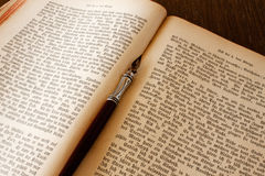 Book and pen. And old open book with a pen Stock Photo
