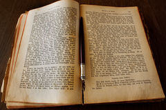 Book and pen. And old open book with a pen Royalty Free Stock Photos