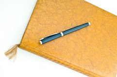 Book and pen. A high key photo of a book or notebook with a pen as the bookmark Royalty Free Stock Images