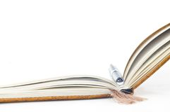 Book and pen. A high key photo of a book or notebook with a pen as the bookmark royalty free stock photo