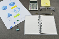 Book, pen, calculator, glasses and financial chart and graph Stock Image