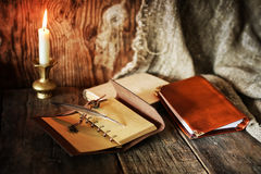 Book pen candle romance Stock Images