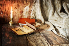 Book pen candle romance Royalty Free Stock Photography