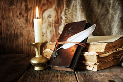 Book pen candle romance Royalty Free Stock Photo