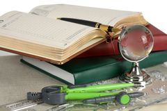 Book, pen  and glass globe Stock Photography