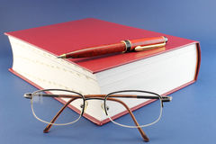 Book pen and glasses Stock Photos
