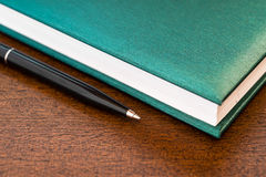 Book and the pen Stock Photo