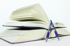 Book and pen Stock Images