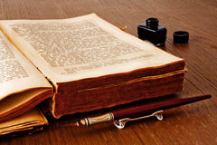Book with a pen and ink. An open book with a pen and ink Stock Photos