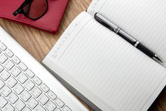 book with pen and keyborad Royalty Free Stock Image