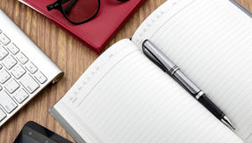 book with pen, mobile and keyborad Stock Image