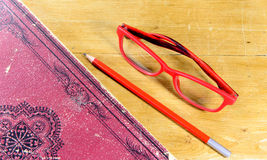 Book, pen and pair of red glasses Royalty Free Stock Photo