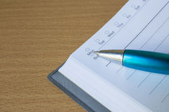Book with pen point to monday Royalty Free Stock Photography