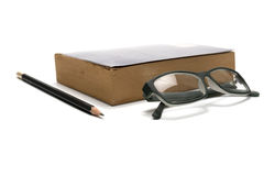 Book pencil and eyeglasses Stock Image