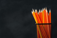 Book and pencil on white table black board background Royalty Free Stock Photos