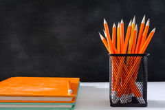 Book and pencil on white table black board background with study Royalty Free Stock Photography