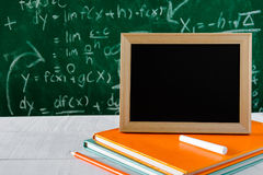 Book and pencil on white table black board background with study Stock Images