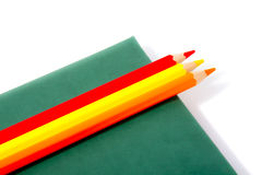Book and pencils. Green book and color pencils Royalty Free Stock Photo