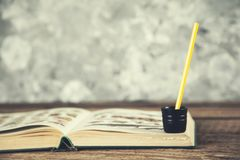 Book with pencils on desk royalty free stock photography