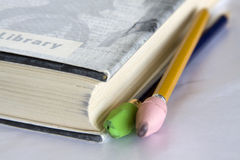 Book, pencils, erasers. Stock Image