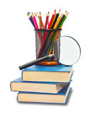 The book, pencils, and magnifying glass Stock Photo