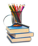 The book, pencils, and magnifying glass Royalty Free Stock Photography