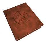 Book with pentacle over the cover Royalty Free Stock Photos