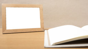 Book and photo frame Royalty Free Stock Photo