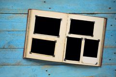 Book with photo frames. Vintage book with empty photo frames, photo corners, free copy space royalty free stock photos