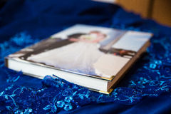 Book for photos. Beautiful classic photo album, photo book. Interesting, light cover, gold corners. Wedding, holiday, event, party, gift, photograph. Great idea Royalty Free Stock Image