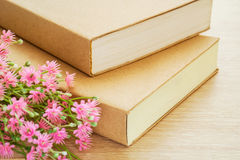 Book and pink flowers Royalty Free Stock Photos