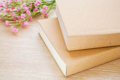 Book and pink flowers Stock Photography