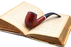Book and  pipe Stock Photography