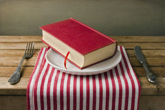 Book on plate Royalty Free Stock Images