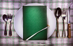 Book on plate Stock Photography