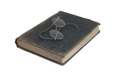 Book with points. Behind the glasses and old book Royalty Free Stock Photography